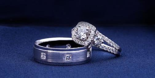wedding ring and wedding band on blue fabric
