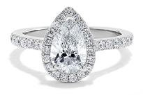 A stunning diamond encrusted Marquis diamond ring with white gold.